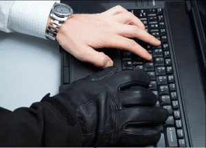 Wire fraud hands on keyboard